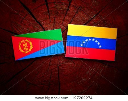 Eritrean Flag With Venezuelan Flag On A Tree Stump Isolated