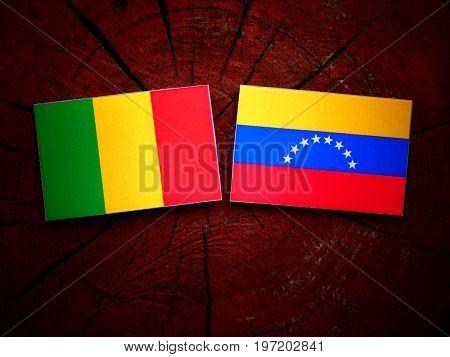 Malian Flag With Venezuelan Flag On A Tree Stump Isolated