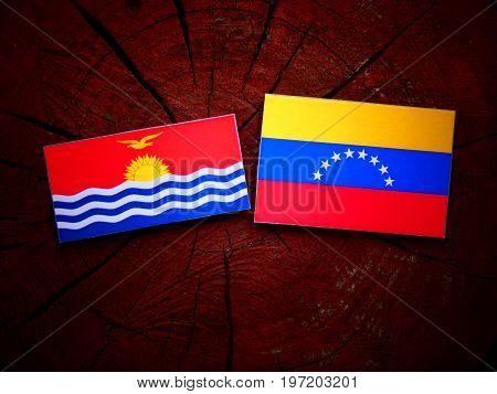 Kiribati Flag With Venezuelan Flag On A Tree Stump Isolated