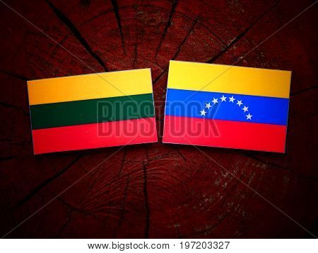 Lithuanian Flag With Venezuelan Flag On A Tree Stump Isolated
