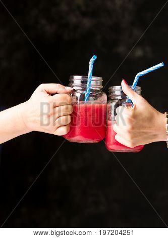 People Clinking  Glasses With Watermelon Smoothie