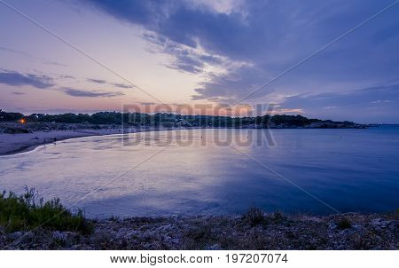 Sunset or blue hour in quiet beach of l'Escala, Costa Brava, Spain. Mediterranean Sea