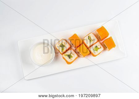 Dessert Maki Sushi - Roll With Various Fruit In Rice Pudding And Coconut Flakes