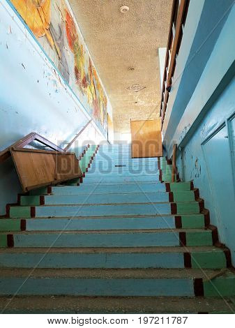 Old Staircase In Interior Of An Abandoned And Ruined Building Of Cultural Center Of Resort. Destroye