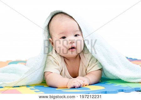 Portrait Of A Little Adorable Infant Baby Girl With Blanket Lying On The Tummy On Colorful Eva Foam