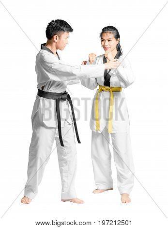 Portrait Of An Asian Man Professional Taekwondo Black Belt Degree (dan) Teaching To Woman's Yellow B