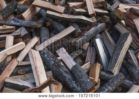 Firewood concept background. Pile of firewood close up