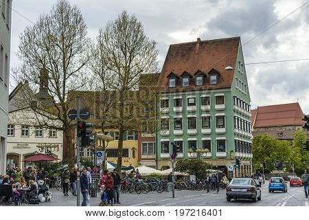 Bamberg old town street with people sitting on the terrace on April 26 2015 in Bamberg Germany.