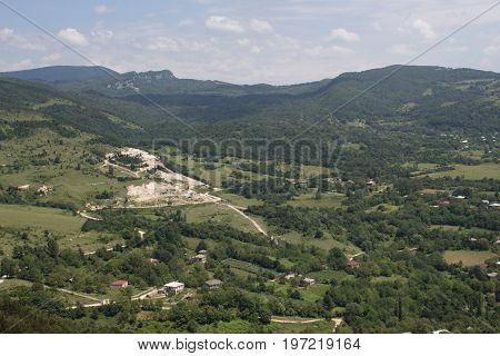 View from a height to village in Imereti area Caucasus mountains in Georgia. Village of houses in mountains