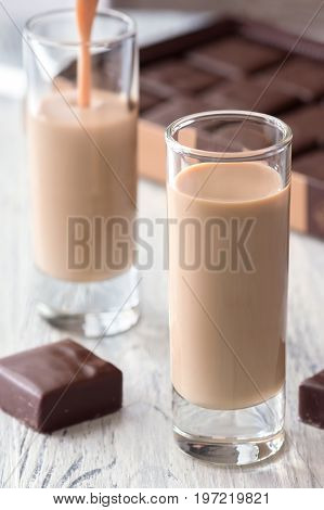 Coffee liqueur in a glass with chocolate sweets