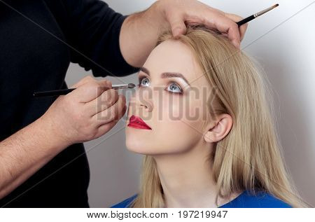 Girl With Grey Eyes And Red Lips Getting Makeup
