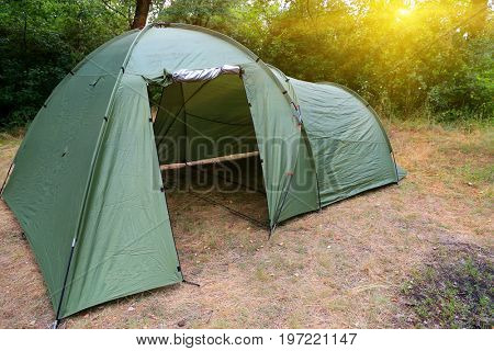 Tourist tent on meadow in forest