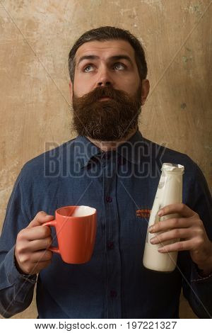 Hipster In Shirt With Yoghurt And Cup.