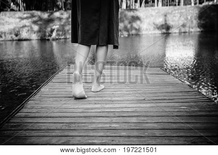 Teenager Girl Making A Step Bootlessly On The Wooden Pier And Moving Forward To The Water, New Oppor