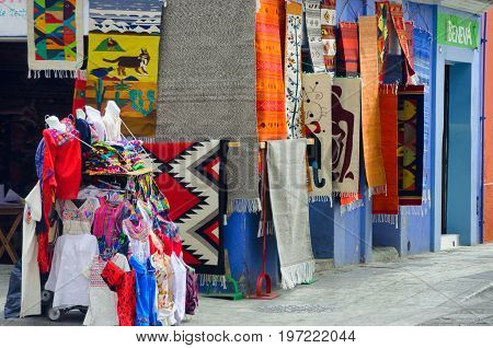 OAXACA MEXICO - MARCH 4: Colorful rugs and clothes for sale in Oaxaca Mexico on March 4 2017