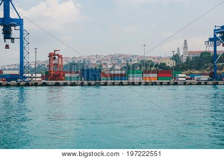 Industrial dock with loading and unloading of sea transport on the Bosporus in Istanbul, Turkey. Storage, business.