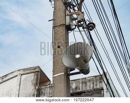 loudspeaker and electric wire on the pole