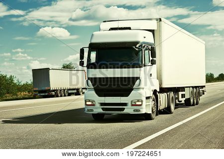 Truck on road, blue sky, cargo transportation concept, yellow toned