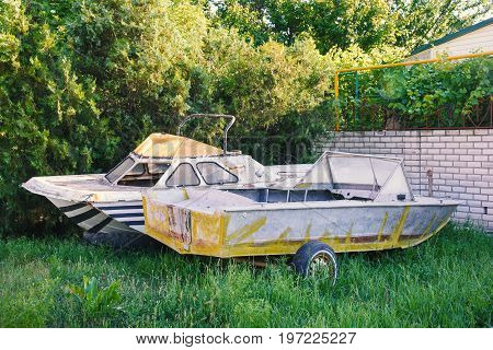 Two old abandoned boats in the yard outdoor