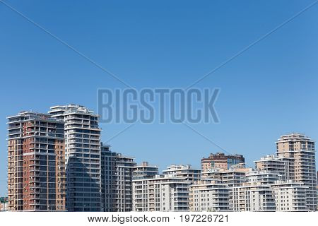 High-rise modern buildings on the river bank