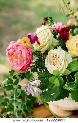 wedding, floral design, applied art, decoration, summer concept - fresh bunch of beautiful blossoms: tender avalanches, english roses, big blooming peony and red dianthuses