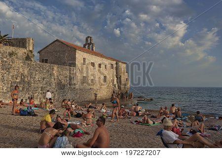 BUDVA MONTENEGRO - JULY 1 2017: On the beach Richard Head in the old city Budva is always crowded