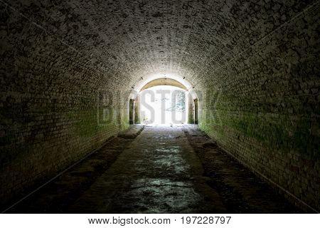 light in end underground tonnel