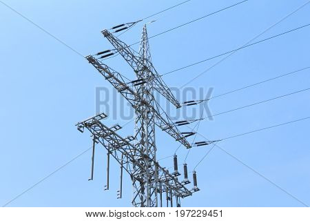 High-tension power line tower carries green electricity energy. Ironman business is transmission of renewable sustainable power to prevent climate change and heal the world. Important modernization of grid.