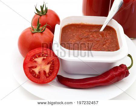 Tomatoes and tomato juice isolated on white background.