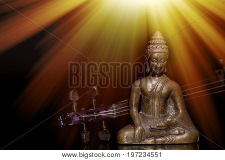 Music therapy. Spiritual new age music with buddha and violin under sun rays of enlightenment. Musical instrument and buddhist figurine. Religious lifestyle or meditational sacred church liturgicalmusic image.