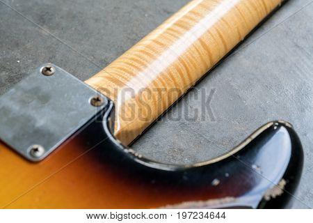 Closeup Of Flame Maple Neck On Sunburst Guitar