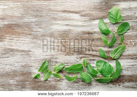 Fresh lemon balm leaves on wooden table