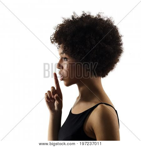 one mixed race african young teenager girl woman Hushing portrait in studio shadow silhouette isolated on white background