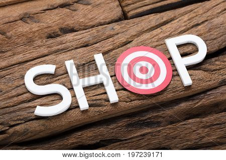 High angle view of shop text with dartboard on wooden table