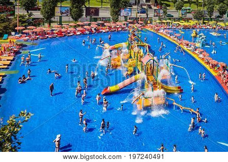 MAMAIA ROMANIA - AUGUST 27 2014: Colorful slides and pipes and blue swimming pool at Acqua Park in Mamaia Romania with an area of ​​4000 square feet of fun pools and water games.