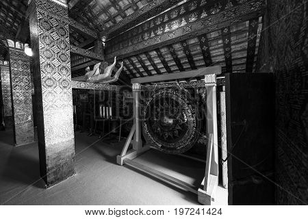 Black and white picture of naga and asian decoration inside Wat Xieng Thong Buddhist temple located in the city Luang Prabang Laos