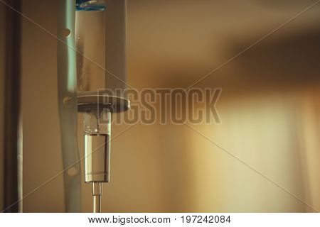 Close Up Saline Solution Drip For Patient And Infusion Bottle With Iv Solution In Patient Room In Ho