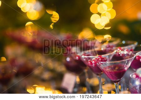 Beautiful Row Line Of Different Colored Alcohol Cocktails On A Party, Martini, Vodka,and Others On D