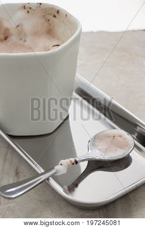 Shiny milk chocolate stain spoon stock photo