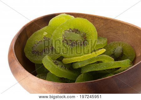 Dried Kiwi Fruit In Wooden Bowl, Dried Preserved Candied Kiwifruit Slices Sugary Sweet Snack Isolate