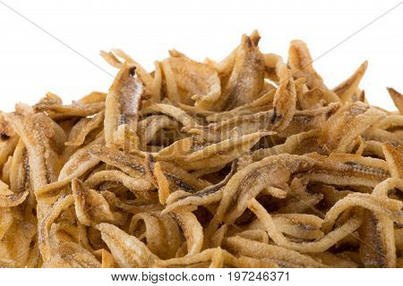 Dried Small Fish Anchovies And Crispy Seafood Isolated On White Background
