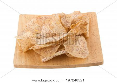 Fried Taro Slices Dip Into The Caramel In A Wooden Tray Isolated On White Background