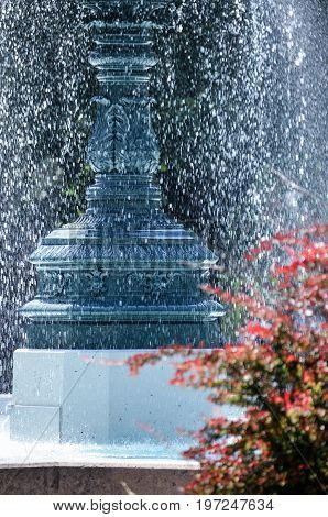 Water Fountain In A Park With Splashing Water In Sunlight In Saint Louis Square In Montreal, Canada