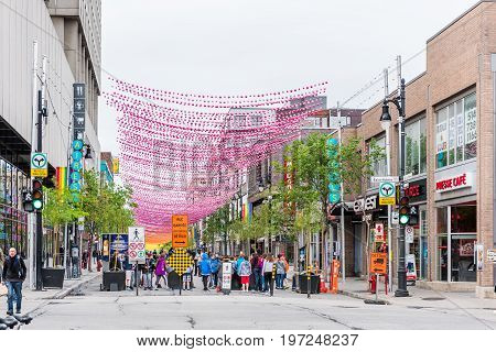 Montreal Canada - May 26 2017: Sainte Catherine street in Montreal's Gay Village in Quebec region with hanging decorations