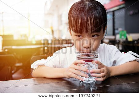 Asian Little Chinese Girl Drinking Water