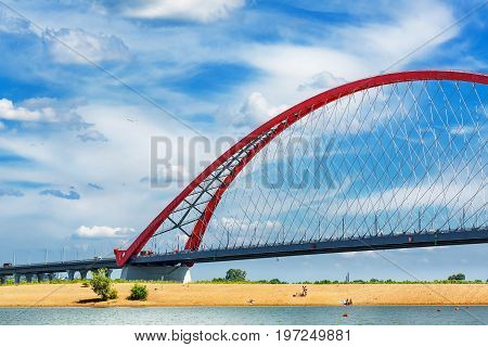 Novosibirsk Siberia Russia - July 17 2017: view of the Ob river beach and Bugrinskij bridge connecting the Kirovsky and Oktyabrsky districts of Novosibirsk