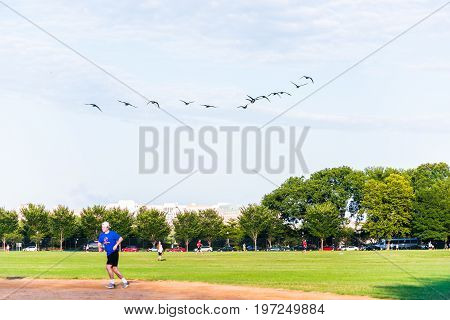 Washington Dc, Usa - August 4, 2016: Happy, Smiling People Playing Baseball On The National Mall Wit