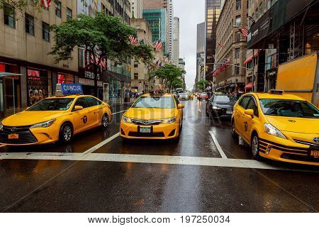 New York - July 2017: Taxi Cars In Times Square, A Busy Tourist Intersection Of Commerce Advertiseme