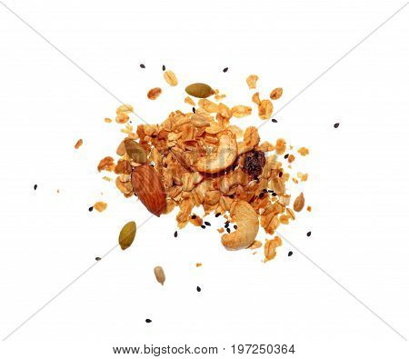 Isolate granola or muesli grain, a top view close photo on granola or muesli pile present a detail in top view of granola or muesli grain isolate on white bright light background, a cereal grain healthy food