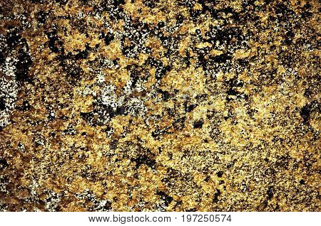 Gold color grunge stained on cement wall, a close up image of a grunge stained on a cement wall present a detail of texture and pattern of grunge stained in a cement wall can use for a background